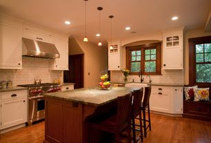 Traditional Kitchen with Bronze cup pull, Window seat, specialty door, Ultracraft destiny shaker cabinetry, L-shaped