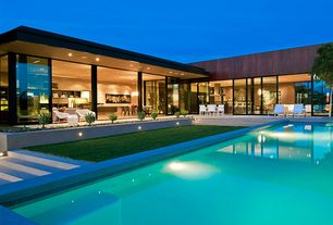 Contemporary Swimming Pool with sliding glass door, exterior stone floors, Pathway, picture window, Lap pool