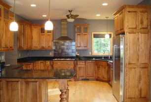 Country Kitchen with Simple granite counters, Ceiling fan, Daltile Metal Fusion Zinc Oxide, Kitchen peninsula, Flush