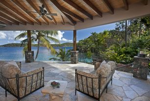 Tropical Porch with Deck Railing, exterior stone floors, Wrap around porch, Fence