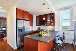 Contemporary Kitchen with U-shaped, European Cabinets, double-hung window, full backsplash, Pendant light, can lights, Flush