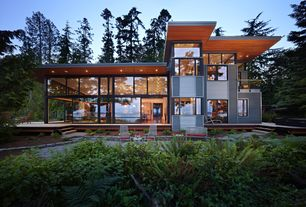 Contemporary Exterior of Home with Curtain wall, Outdoor furniture, Accent exterior architectural lighting