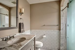 Craftsman 3/4 Bathroom with penny tile floors, Flat panel cabinets, Inset cabinets, frameless showerdoor, Wall sconce