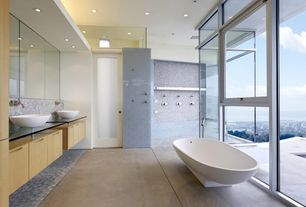Contemporary Master Bathroom with Concrete floors, Double sink, Freestanding, penny tile floors, Penny Tile, can lights