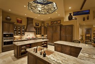 Traditional Kitchen with Breakfast bar, Framed Partial Panel, L-shaped, double wall oven, Custom hood, Stone Tile, can lights