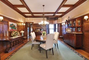 Craftsman Dining Room with Chandelier, Crown molding, double-hung window, Standard height, Wainscotting, Wall sconce