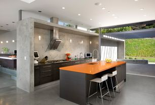 Modern Kitchen with Kitchen island, Breakfast bar, One-wall, Soapstone counters, Pendant light, Undermount sink, High ceiling