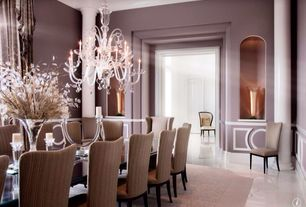 Art Deco Dining Room with Chandelier, Columns, Wainscotting, Concrete floors, Standard height