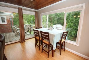 Traditional Dining Room with picture window, Standard height, Hardwood floors