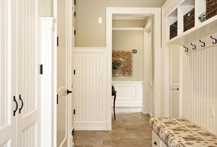 Traditional Mud Room with limestone floors, Built-in bookshelf, Wainscotting, Crown molding, Standard height, specialty door