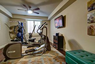 Traditional Home Gym with Hardwood floors, Nautilus E614 Elliptical, Schwinn 230 Recumbent Exercise Bike, Ceiling fan