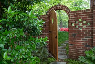 Traditional Landscape/Yard with Gate, Arbor, Fence, Pathway, exterior stone floors, Rhododendron