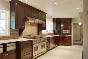 Cottage Kitchen with Raised panel, Double oven gas range, Stone Tile, Herringbone tile pattern, Pendant light, One-wall