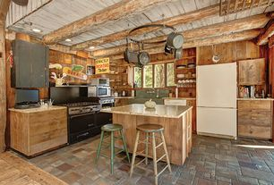 Rustic Kitchen with stone tile floors, slate tile floors, Kitchen island, Freestanding Full Size Top Freezer Refrigerator