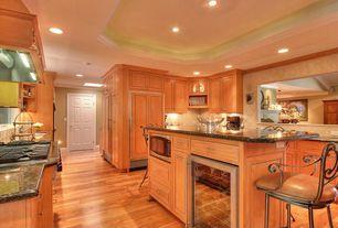 Mediterranean Kitchen with U-shaped, Complex granite counters, Inset cabinets, Hardwood floors, White interior 6-panel door