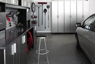 Contemporary Garage with French doors, Concrete floors, High ceiling, Ultracompact surface countertop