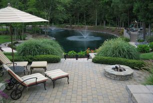 Traditional Patio with Fence, Fire pit, Fountain, Outdoor lounge chairs, Pond, Private wooded setting, Gate, Raised beds