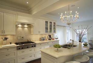 Traditional Kitchen with Crown molding, Flush, Glass panel, Chandelier, Custom hood, Sandstone, One-wall, Breakfast bar