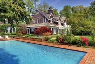 Traditional Swimming Pool with exterior brick floors, Outdoor kitchen, Raised beds