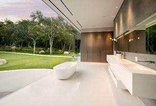 Contemporary Master Bathroom with Standard height, Corian counters, Bathtub, Floating vanity, picture window, Paint, Flush