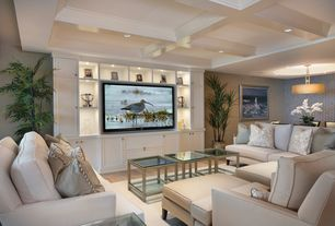Contemporary Living Room with High ceiling, Tech lighting mulberry drum pendant, Hardwood floors, Built-in bookshelf