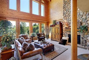 Rustic Living Room with picture window, High ceiling, simple granite floors, Exposed beam, Fireplace, Arched window, Columns