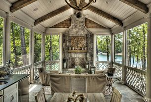 Rustic Porch with outdoor pizza oven, Outdoor kitchen, Wrap around porch, exterior stone floors