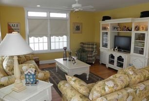 Cottage Family Room with Built-in bookshelf, Safavieh Bosco Coffee Table, Hardwood floors, Ceiling fan