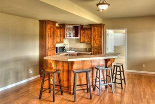 Craftsman Bar with flush light, Laminate floors, six panel door, Built-in bookshelf, Standard height