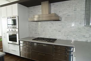 Contemporary Kitchen with Flat panel cabinets, L-shaped, European Cabinets, Flush, Corian counters, Marble mosaic backsplash