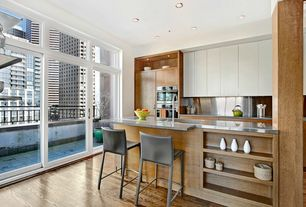Modern Kitchen with electric cooktop, double wall oven, picture window, Undermount sink, Kitchen island, Flush, French doors