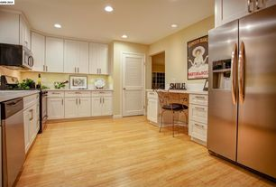 "Traditional Kitchen with Built In Refrigerator, Flush, 4"" stainless bar pull, built-in microwave, Light wood floors, Paint 1"