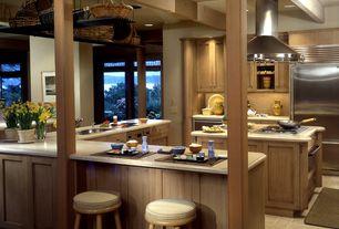Craftsman Kitchen with limestone tile floors, Flat panel cabinets, Limestone counters, Breakfast bar, Exposed beam, U-shaped