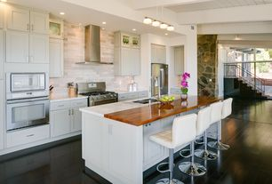 Contemporary Kitchen with full backsplash, Breakfast bar, Multiple Sinks, Complex marble counters, can lights, Exposed beam