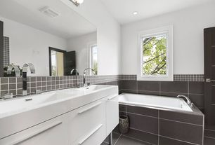 Contemporary Master Bathroom with Corian counters, Standard height, wall-mounted above mirror bathroom light, Wall Tiles