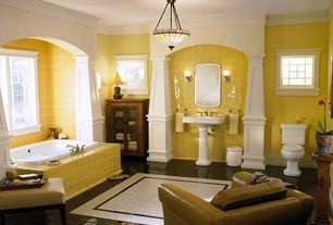 Craftsman Master Bathroom with Standard height, Wall sconce, picture window, Bathtub, stone tile floors, Pedestal sink