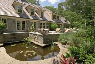 Traditional Exterior of Home with Pond, French doors, Pathway, exterior stone floors