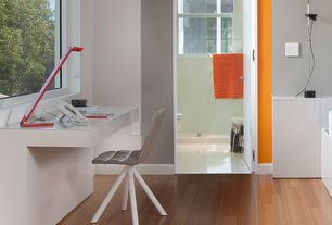 Contemporary Home Office with Laminate floors