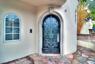 Mediterranean Front Door with Arched window, Fence, exterior stone floors