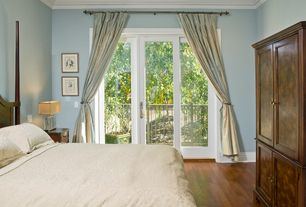 Traditional Master Bedroom with Hardwood floors, French doors, Standard height, Crown molding