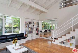 Modern Living Room with High ceiling, Built-in bookshelf, Hardwood floors, Exposed beam