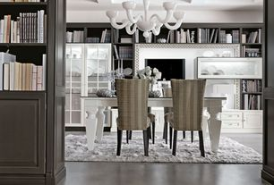 Eclectic Dining Room with Chandelier, Concrete floors, Exposed beam, Built-in bookshelf