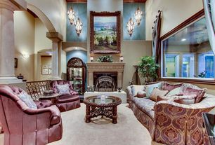 Traditional Living Room with Columns, metal fireplace, stone fireplace, Hardwood floors, High ceiling, Pendant light