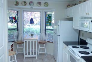 Kitchen with Bay window, Breakfast nook, Raised panel, One-wall, Soapstone, limestone tile floors, Flush, Pendant light