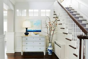 Cottage Entryway with can lights, Classic ceramic bottle table lamp, Hardwood floors, Standard height, Paint 1, Chair rail