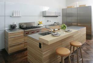 Modern Kitchen with Corian counters, European Cabinets, Standard height, Flush, Hardwood floors, Breakfast bar, L-shaped