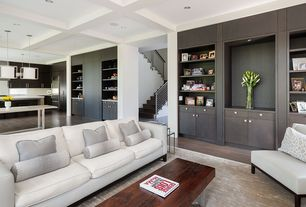 Contemporary Great Room with Built-in bookshelf, Standard height, Hardwood floors, Box ceiling, can lights, Pendant light