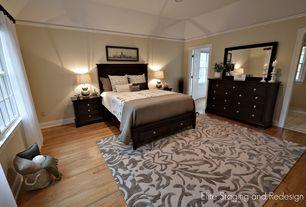 Contemporary Master Bedroom with six panel door, Hardwood floors, Crown molding, Standard height, can lights