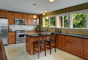 Traditional Kitchen with Stone Tile, Pendant light, Breakfast bar, Quartz counters, Canyon Creek Shaker Cabinetry, Flush