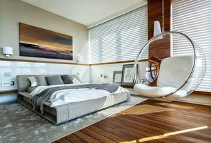Modern Master Bedroom with West Elm Watercolor Solid Rug, Chair rail, Hardwood floors, Molteni & C Clip Bed, Wall sconce
